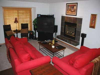 Sunriver house rental - Another View Of Living Room - Large screen tv and gas fireplace.