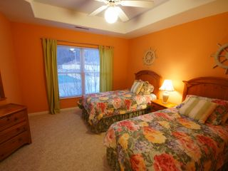 Lake Ozark condo photo - The Twin bedroom with a view of the Pool and Tennis Court