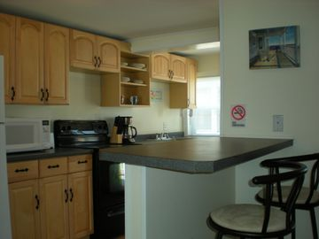 Fully applianced Kitchen with microwave and coffee maker