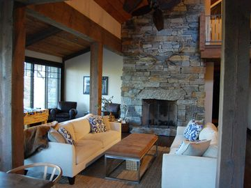 Stone fireplace, mid-century & modern furniture, foosball, & mountain views