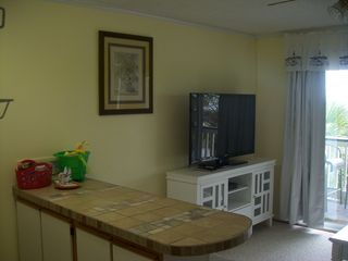 52 inch flat screen in the living area! - Isle of Palms condo vacation rental photo
