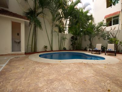 Playa del Carmen condo rental - pool with sun loungers
