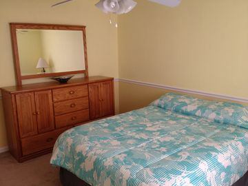 The second BR features a large queen size bed with full dresser and large closet