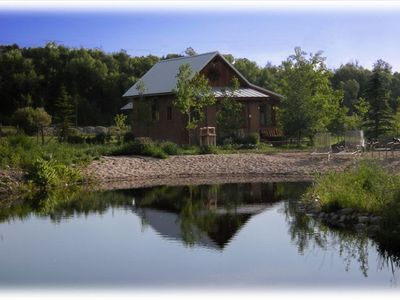 Charming guest house next to private pond and beach for sunning and camp fires
