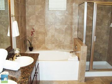 Stunning Ensuite with granite tops and double sinks. High pressure Delta Shower.