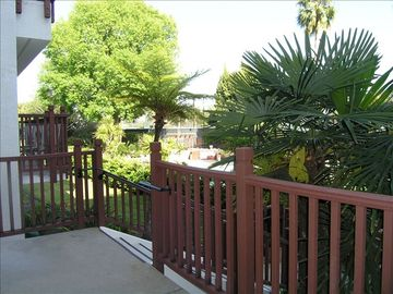 Walkway to pool area behind building