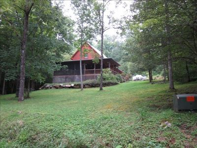Bandit Creek Cabin sits on 1.5 acres of gently sloping land