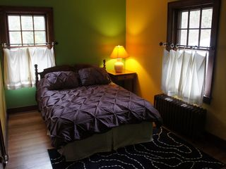 Phoenicia house photo - Madri Gras room with New Orleans colors and art. Full size bed.
