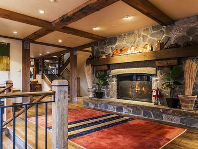 Grand entrance with massive stone fireplace