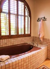 Large soaking tub in the master bedroom bathroom - La Jolla house vacation rental photo