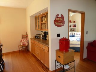 Oneida Lake cottage photo - Eat-in area has breakfast side board and china for 8+