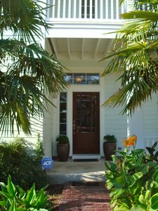 Tropical & private yet warm and inviting front entry.