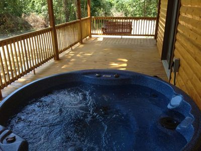 The hottub is located on the back deck with plenty of privacy near Beavers Bend