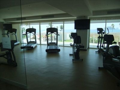 Fully equipped gym with fitness center.