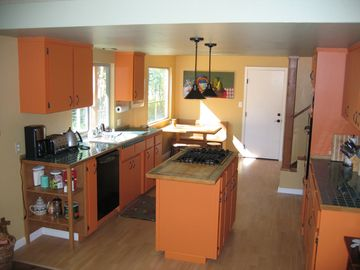 kitchen has a kitchen nook in its far end; it has all new kitchen appliances