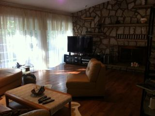New Buffalo house photo - Living room with fireplace and attached deck