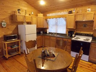 kitchen and dining area - fully stocked for your convenience - Muddy Pond cabin vacation rental photo