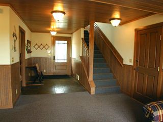 Bandon house photo - Foyer and stairway to upper level.