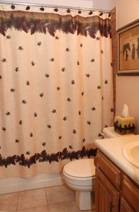 Pine Cone theme bathroom with new tile floor