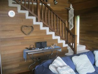 Camano Island house photo - Living room with stairs to the loft, also Ipod docking station.