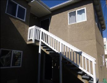 Stairs leading to the second floor 2 bedroom unit in the back of the house