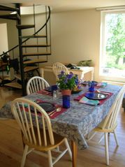 Castine cottage photo - Spacious dining room and spiral staircase