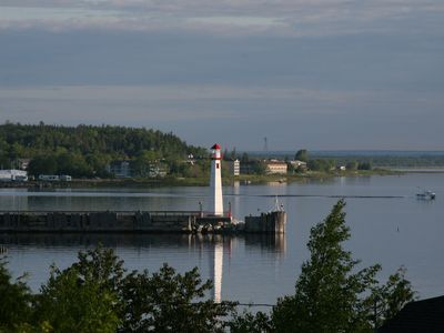 Panoramic View Of Mackinaw Island And Lighthouse In St. Ignace Bay