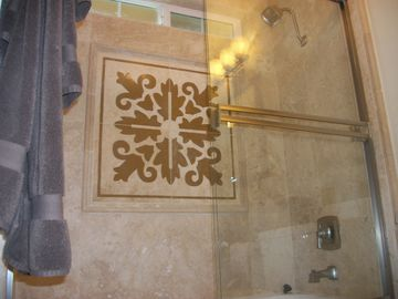 Marble and glass-door showers with rain curtain shower heads~