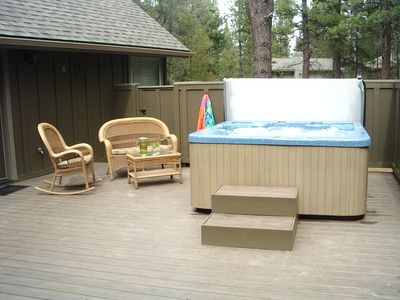 Large hot tub on private deck.