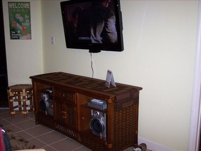 Newly mounted flat screen TV and stereo in living room