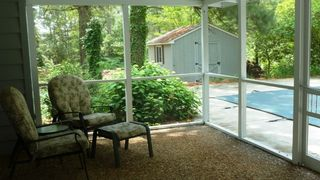 Cape Charles cottage photo - Seating area in the enclosed screened patio