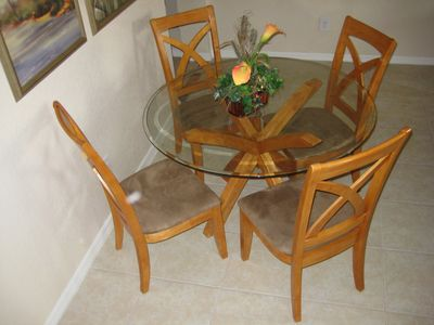 Regal Palms townhome rental - Table seats 6 and two folding chairs are available