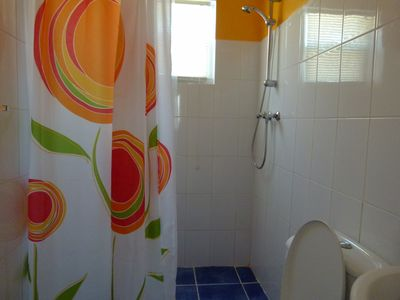 (2) freshly painted full bathrooms on the 1st floor with new linens