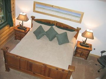 master suite bedroom (king bed, built in tv, sitting area).