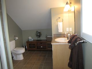 Shuswap Lake townhome photo - loft bathroom with shower and two access doors