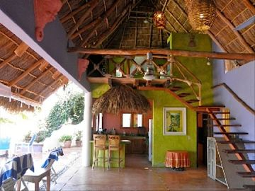 PALAPA, view to kitchen, with steps to master suite. 2nd Bathroom on Main Floor.