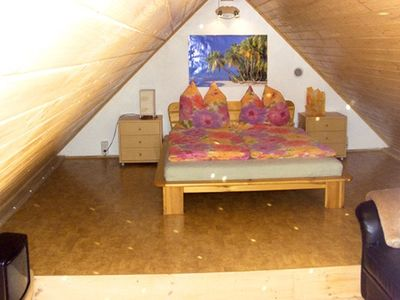 Attic right with double bed and sofa