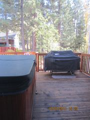 Heavenly Valley house photo - Spacious back deck with hot tub and 6 burner Weber gas grill