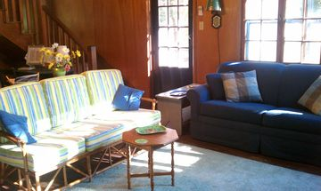 Comfortable living room leads to the screened porch.