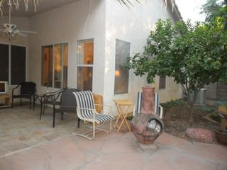 At night, light the chiminea under the lemon tree and watch the AZ sunset. - Phoenix house vacation rental photo
