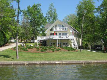 Weiss Lake house rental - View from lake. Includes private paved boat launch and detached double carport