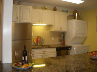 St. Simons Island condo photo - New stainless steel appliances and granite countertops.