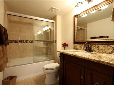 Totally Remodeled Second Bathroom with Shower over the Tub. Stone Tile & Granite