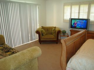 Fort Lauderdale house photo - Huge master bedroom suite has HDTV, sofa and easy chair.