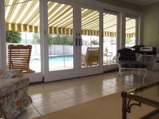 Brigantine house photo - .Sunroom with wet bar looks out into the pool area.