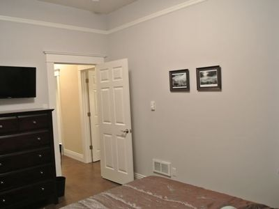Bedroom 2 (different angle) with queen bed, 6 drawer dresser and 32' TV.