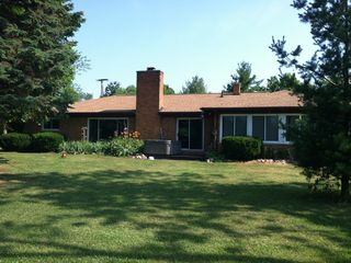 Pinckney house rental - This side of the house faces the lake - great views from all rooms.