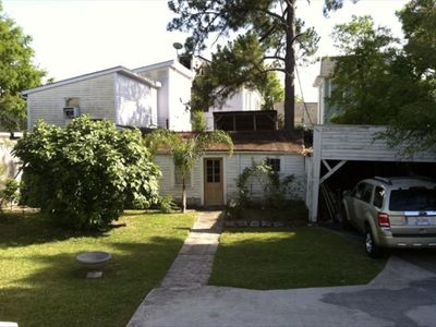 New Orleans cottage rental - Off-street parking, car port, sheds for storage; fig tree