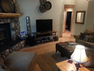 Sunriver house photo - Great room fireplace and TV with upgraded cable sports, HBO & Showtime