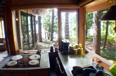 Interlochen cottage rental - Kitchen looking out to stairs leading down to lake
